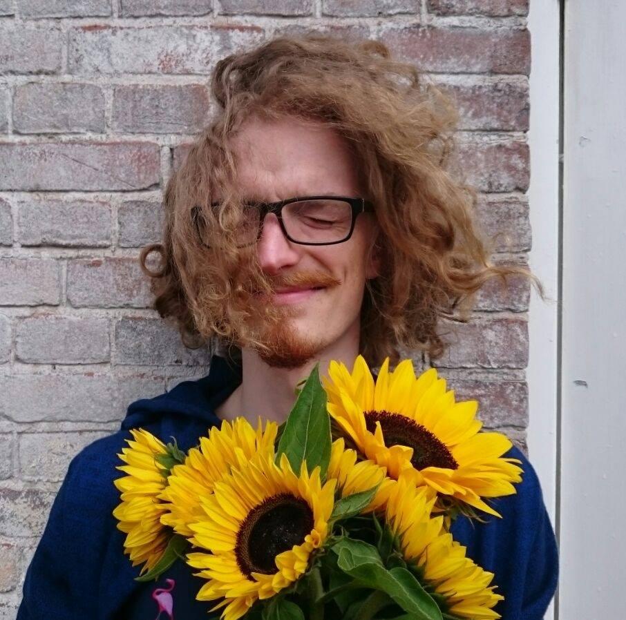 Kristjan Kalde portrait with flowers